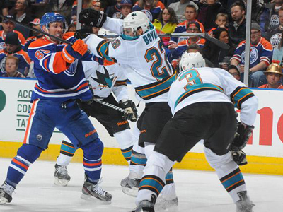 Sharks crash Oilers party with six goal first period