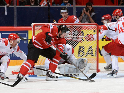 Duchene scores twice, leading Canada over Denmark in tournament opener