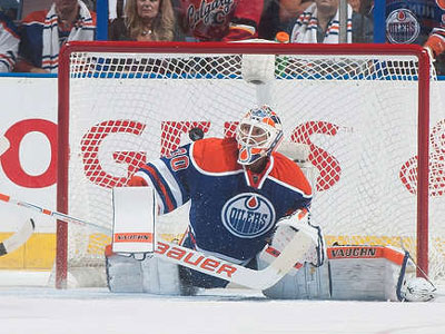 Oilers, Scrivens come up short in opening night loss to Flames