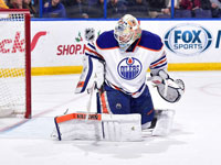 Scrivens keeps Oilers from another lopsided defeat in St. Louis