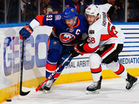 Islanders top Senators for Halak