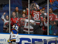 Brodeur earns win in relief, Blues defeat Islanders